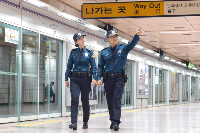 Police officers patrol a subway station to prevent criminal activities. Yonhap