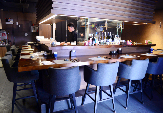 Sazanka, which opened in Seoul's Sinsa-dong in November, serves kaiseki-style eats in a casual and intimate setting. (Park Hyun-koo/The Korea Herald)