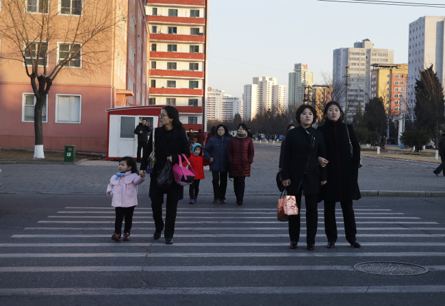 Women walk through the streets of downtown Pyongyang, North Korea, Thursday, March 7, 2019. (AP)