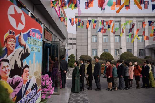 Voters queue to cast their ballots at the '3.26 Pyongyang Cable Factory' during voting for the Supreme People's Assembly elections, in Pyongyang on Sunday. (AFP-Yonhap)
