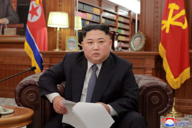 North Korean leader Kim Jong-un gives a New Year's speech in Pyongyang on Jan. 1. (Reuters-Yonhap)