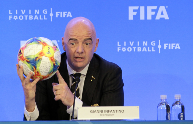 FIFA President Gianni Infantino holds a soccer ball as he speaks during a press conference after the FIFA Council Meeting, Friday, March 15, 2019, in Miami.(AP)
