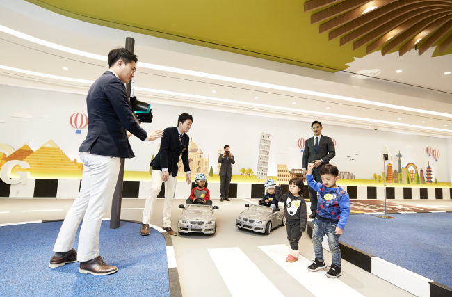 Children have fun driving and learning about road safety at the BMW Kids Driving Zone in Paradise Hotel Busan. / Paradise Hotel Busan