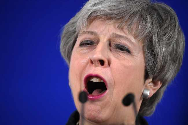 British Prime Minister Theresa May holds a press conference on March 22 at the end of the first day of an EU summit focused on Brexit, in Brussels. (AFP)