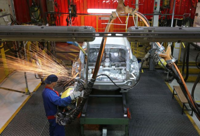 A worker welds body panels on the shell of a Ford Focus automobile at a Ford Sollers plant in Saint Petersburg, Russia. (Bloomberg)
