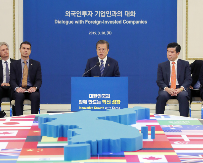 President Moon Jae-in addresses leaders of foreign businesses and organizations at the presidential office on Thursday. Yonhap