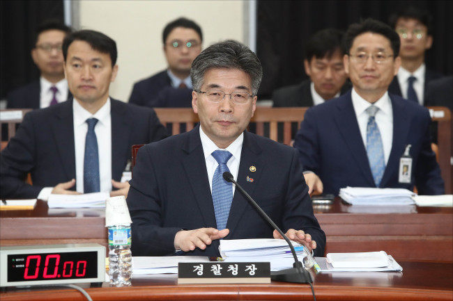 Chief of the National Police Agency Min Gap-ryong attend a briefing with the National Assembly's intelligence committee on Tuesday. (Yonhap)
