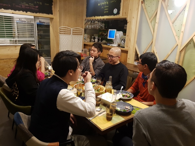 Participants of the social dining club Jingu's Table have dinner together and share their stories. (Jingu's Table)