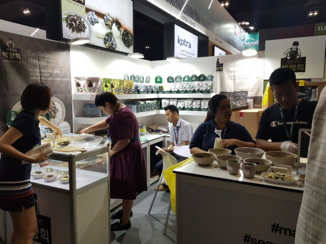 South Korean firms promote their halal items in booths prepared by the KOTRA at MIHAS 2019 in Kuala Lumpur. (Jung Min-kyung/ The Korea Herald)