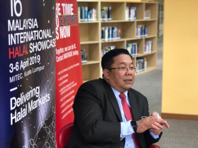 Sirajuddin Suhaimee, director of JAKIM talks to reporters on the sidelines of MIHAS 2019 on Wednesday in Kuala Lumpur. (MATRADE)