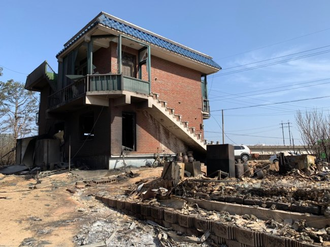 Only a few of the houses in the village remain standing. (Kim Arin/The Korea Herald)