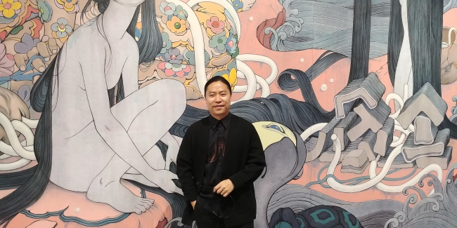 Visual artist James Jean poses for pictures during a press conference on April 3 at Lotte Museum of Art, Seoul (Yonhap)