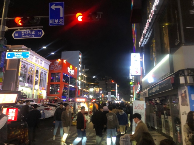 A street in Hongdae, one of popular nightlife districts in western Seoul, is filled with people at around midnight on Saturday.