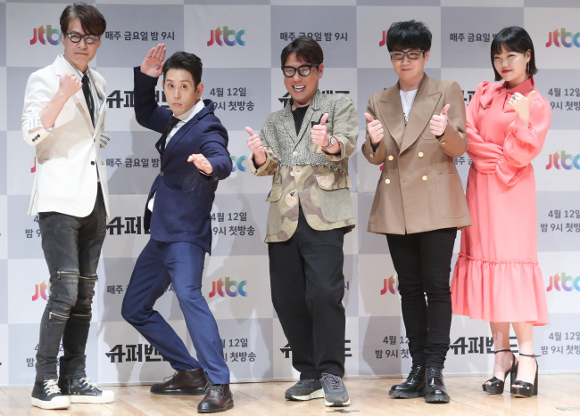 From left: Yoon Sang, Joe Hahn of Linkin Park, Yoon Jong-shin, Kim Jong-wan of Nell and Suhyun of Akmu pose for photos during a press event at the JTBC headquarters in Digital Media City, western Seoul, Thursday. (Yonhap)