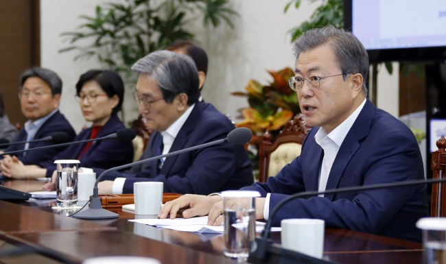 President Moon Jae-in presides over the meeting with senior aides at the presidential office on Monday. (Yonhap)