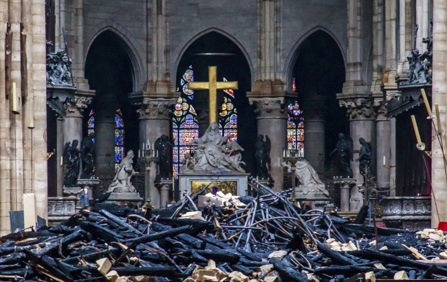 Debris are seen inside Notre Dame cathedral in Paris, Tuesday. (AP-Yonhap)