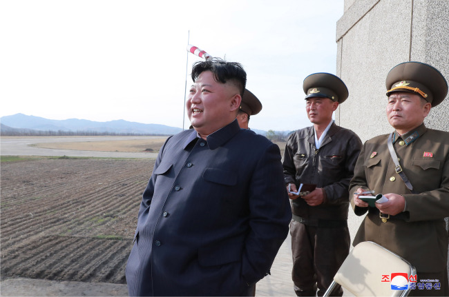 North Korean leader Kim Jong-un is seen watching a North Korean Air Force drill Tuesday. This is the first time Kim has inspected a military event since November, when he reportedly attended the testing of a newly developed weapons system. Yonhap