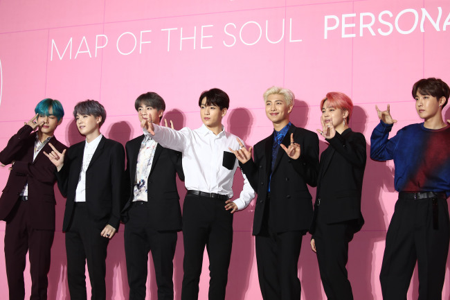 "BTS poses before a press conference for ""Map of the Soul: Persona,"" in Seoul on Wednesday. From left are V, Suga, Jin, Jungkook, RM, Jimin and J-Hope. (Yonhap)"