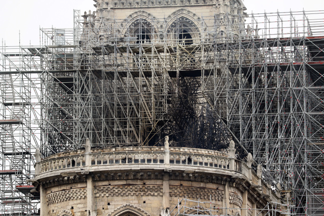 The devastating fire at Notre Dame Cathedral in central Paris has been put out after burning for 15 hours, local media reported on Tuesday. (Yonhap)