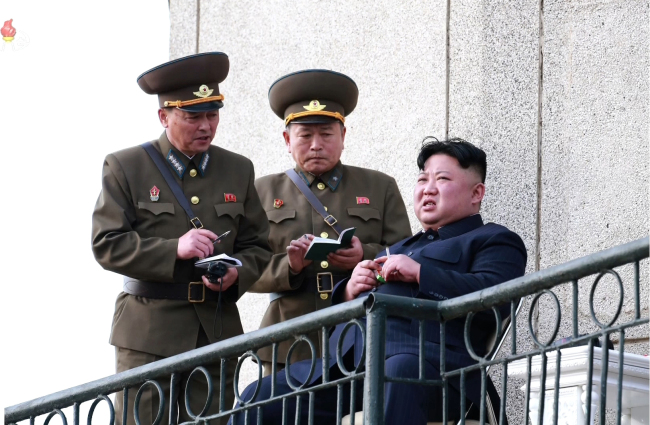 North Korean leader Kim Jong-un is seen inspecting an air force drill on Tuesday. Yonhap