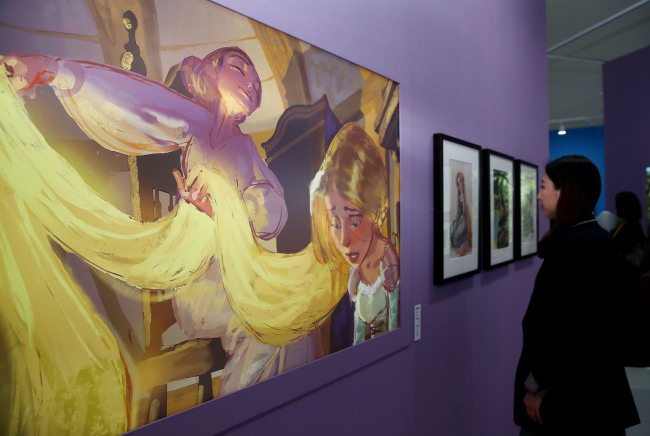 "A visitor looks around ""The Art of Disney: The Magic of Animation"" exhibition at Dongdaemun Design Plaza in Seoul on Wednesday. (Yonhap)"