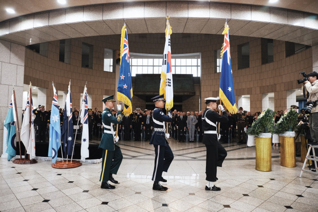 The flags of New Zealand, South Korea and Australia are paraded during an Anzac Day celebration at the War Memorial of Korea in Seoul on Thursday. (Australian Embassy of Korea)