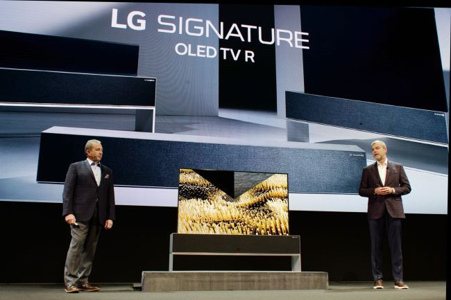 Timothy Alessi (left), a US product marketing team leader, and David Vanderwaal, a US marketing division leader, present LG Electronics' LG Signature OLED TV R at the Consumer Electronics Show 2019 in Las Vegas, in January. (LG Electronics)