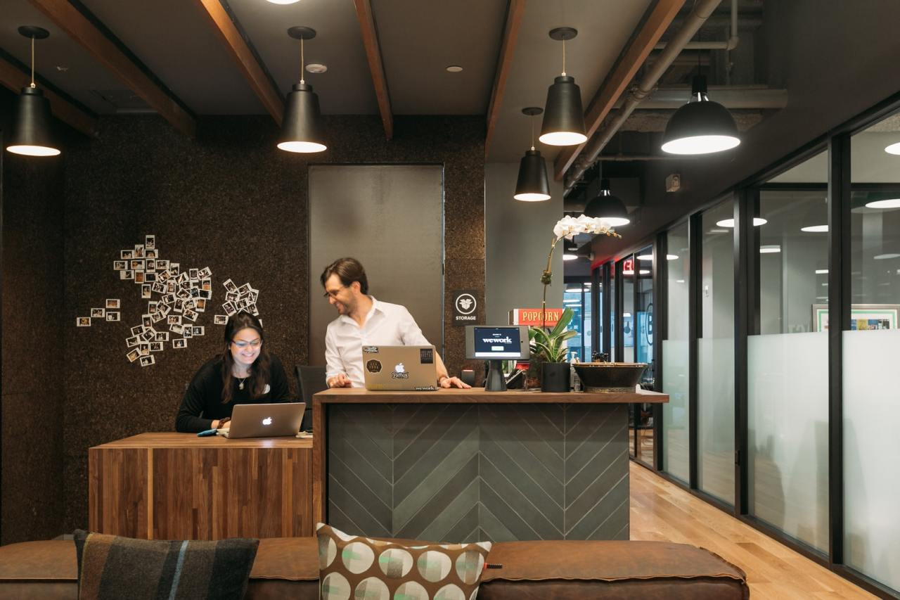 Staff members of coworking space firm WeWork work at the company`s headoffice in New York City. (WeWork)