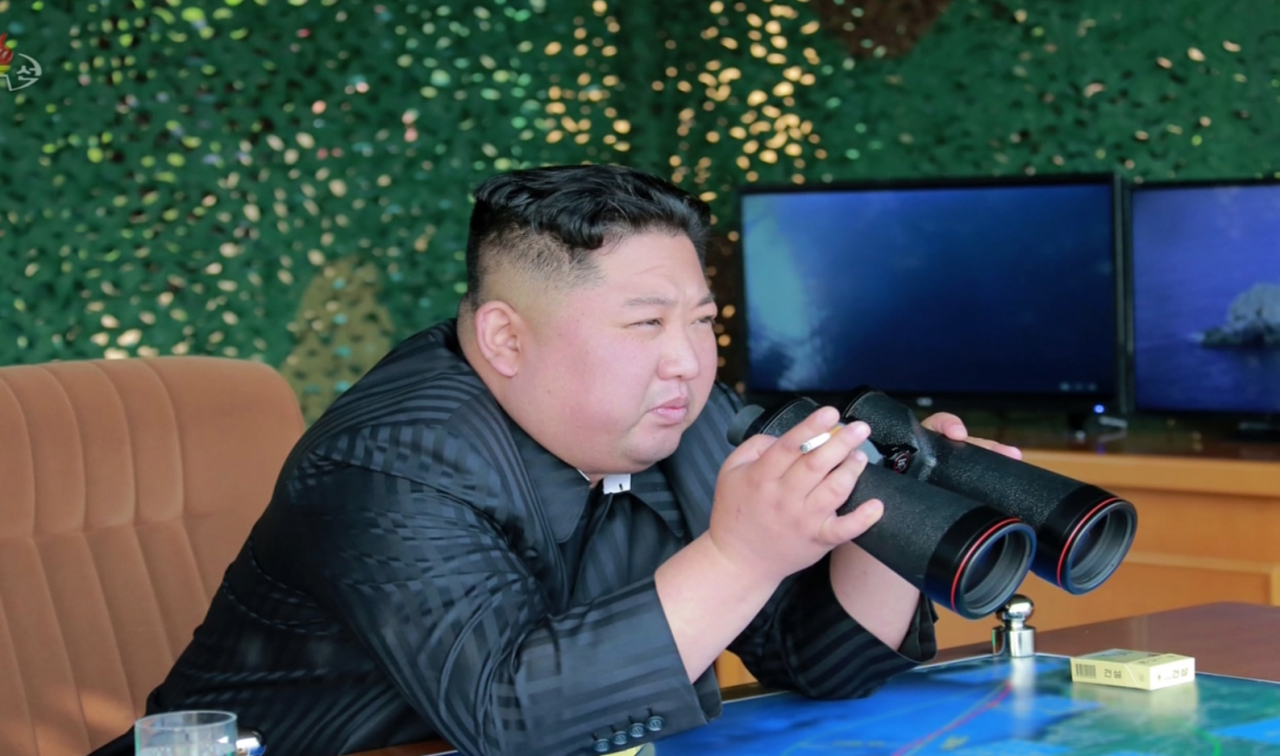 North Korean leader Kim Jong-un is seen inspecting a weapons test in a photograph released by the Korean Central News Agency. Yonhap