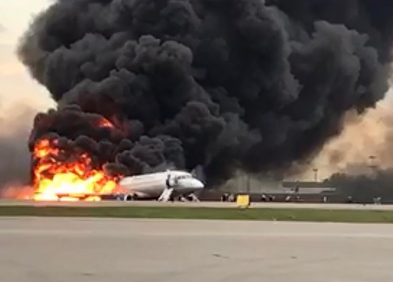 This handout picture taken and realeased on May 5, 2019, by the Investigative Committee of Russia shows a fire of a Russian-made Superjet-100 at Sheremetyevo airport outside Moscow. - The Interfax agency reported that the plane, a Russian-made Superjet-100, had just taken off from Sheremetyevo airport on a domestic route when the crew issued a distress signal. (AFP-Yonhap)