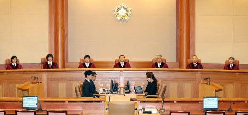 From left: Justices Lee Eun-ae, Lee Seon-ae, Seo Gi-seog, Chief Justice Yoo Nam-seok, Cho Yong-ho, Lee Suk-tae and Lee Jong-seok sit on the bench at the Constitutional Court in central Seoul on April 11. (Yonhap)