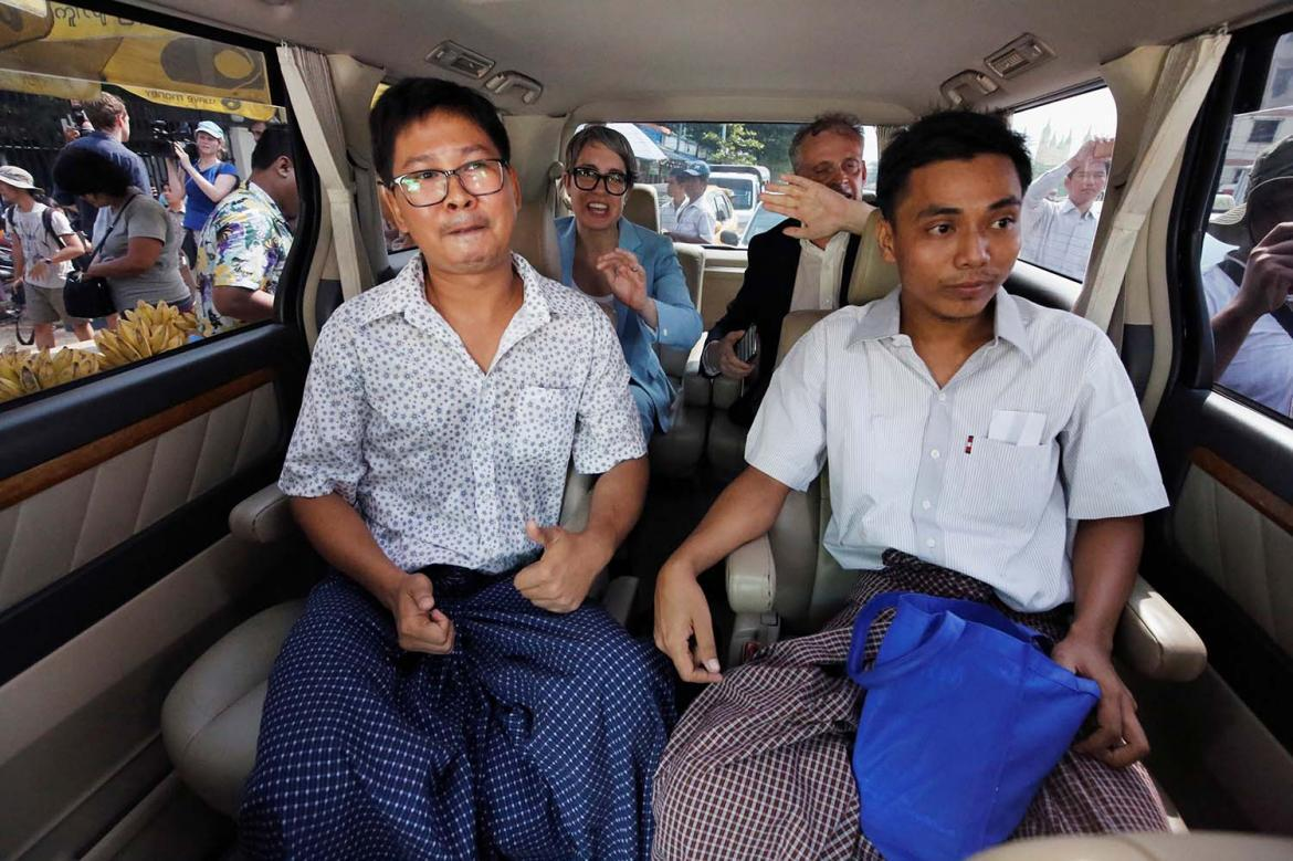 Reuters journalists Kyaw Soe Oo (right) and Wa Lone sit in a vehicle after being released from Insein Prison in a presidential pardon on May 7 (AFP)