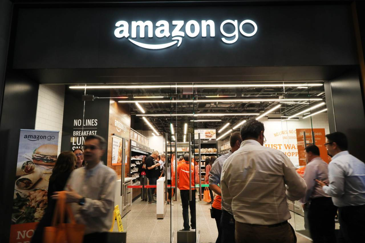 People shop at the newly opened cashier-less Amazon Go Store in New York City on May 7, 2019. (AFP)