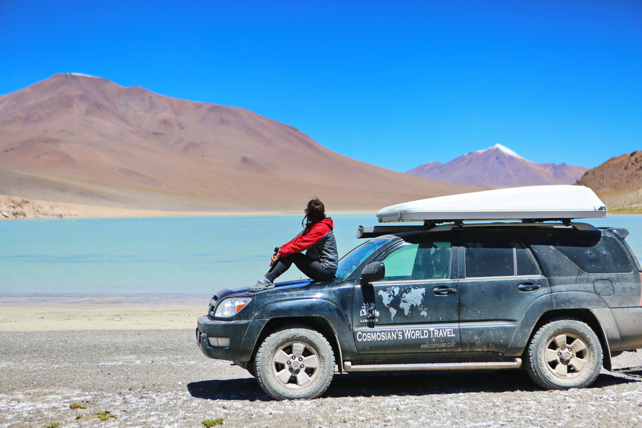Shin Seon-a at the Eduardo Avaroa Andean Fauna National Reserve in Bolivia. She has traveled 47 countries in this rugged 4x4 off-load vehicle with her husband Yoon Jin-young for nearly three years. (Photo provided by Shin)