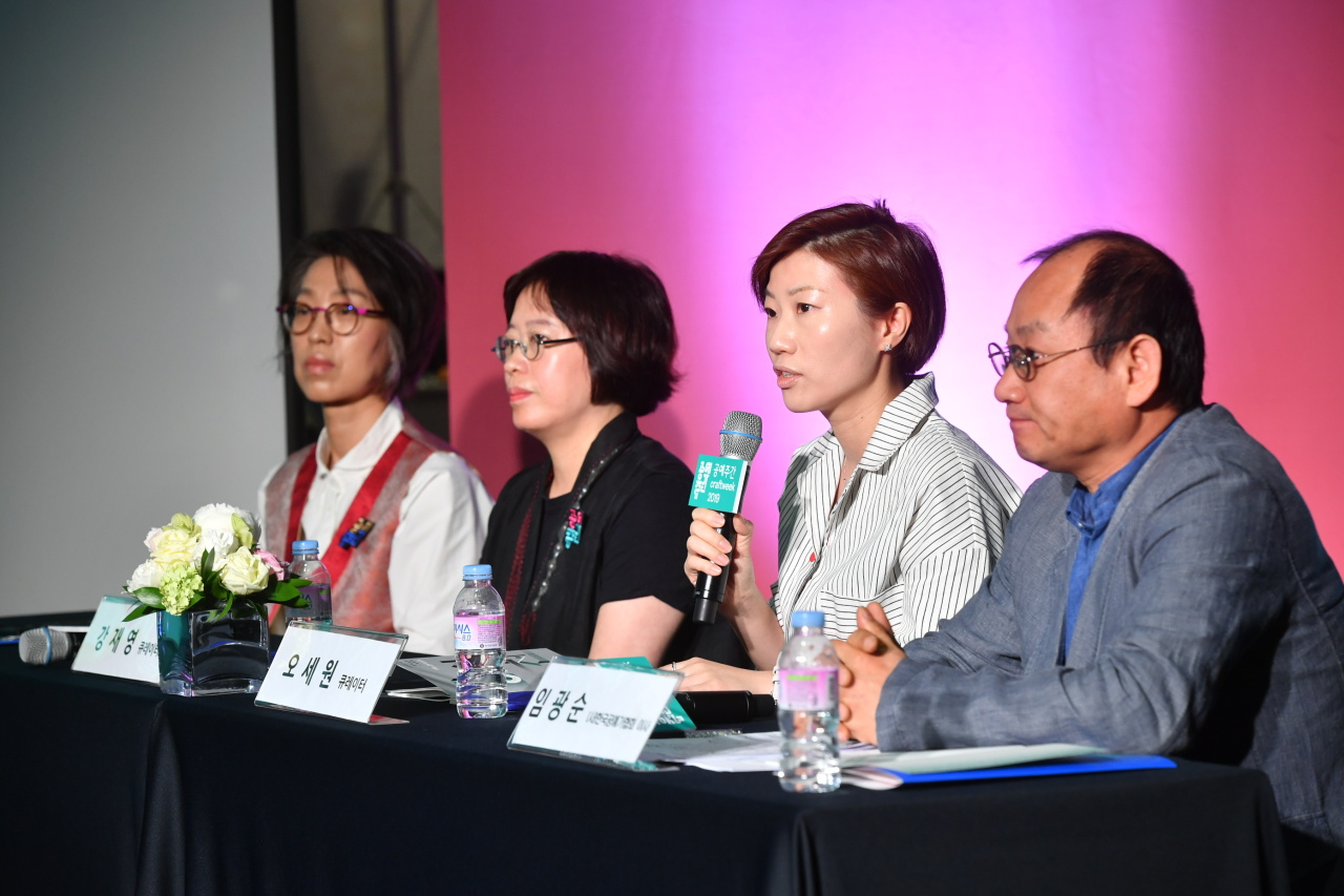 "Officials and curators of ""Craft Week 2019"" speak during a press conference Friday at Culture Station Seoul 284 in central Seoul. (KCDF)"