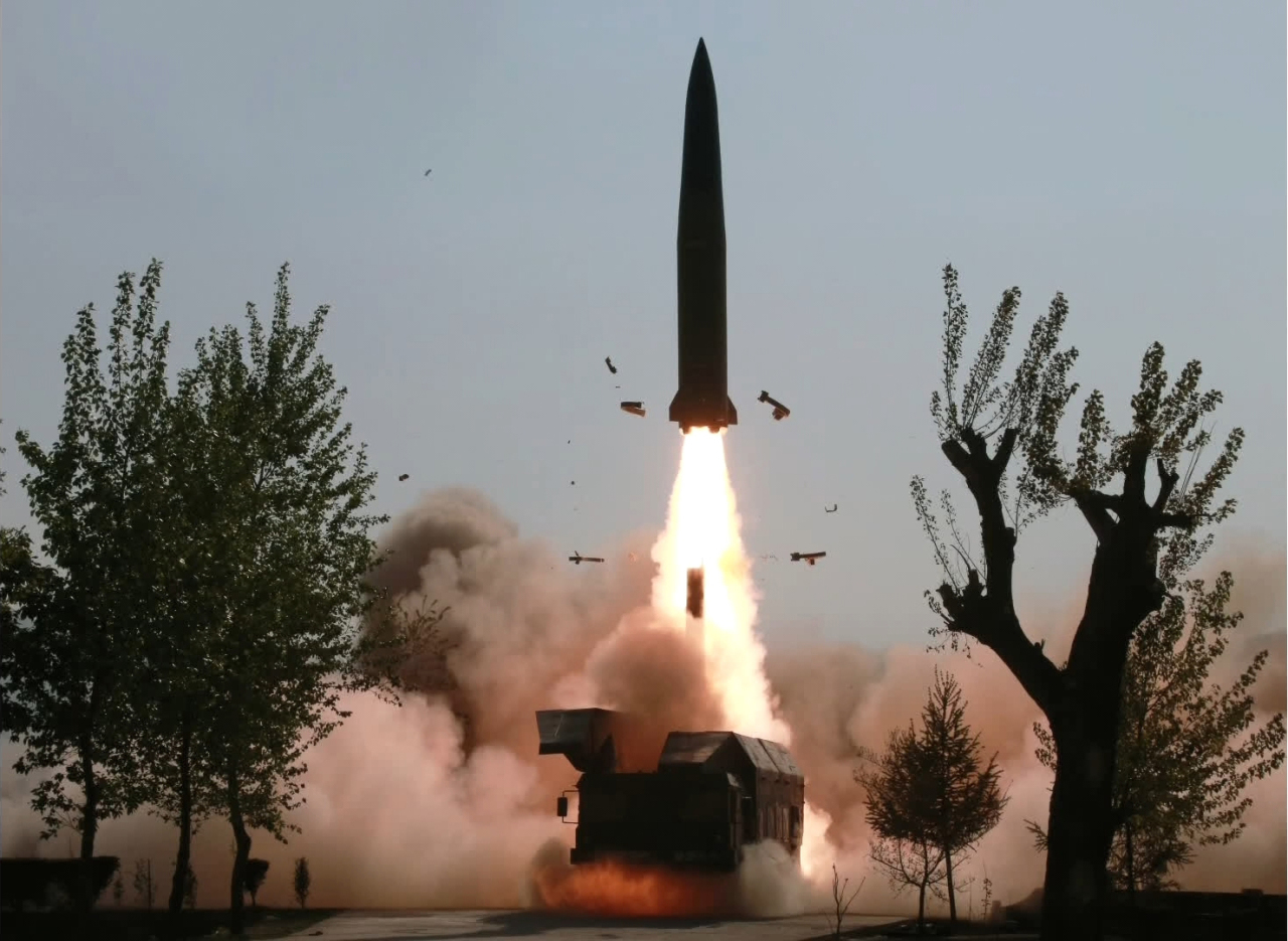 North Korea fires a projectile in Kusong, North Pyongan Province, on May 9. (Yonhap)