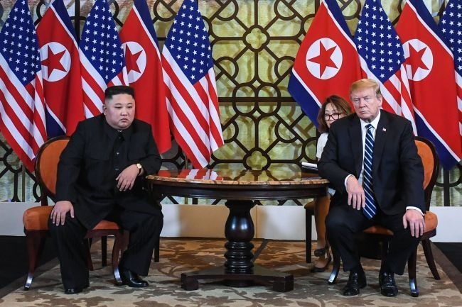 US President Donald Trump and North Korean leader Kim Jong-un sit next to each other at the start of their summit in Hanoi on Feb. 28. (Yonhap)