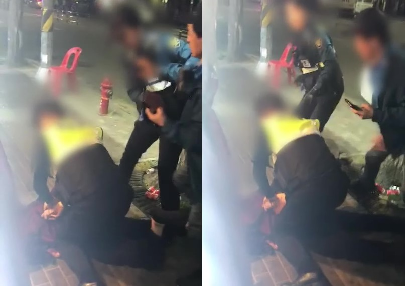 A screen grab of the video shot by a citizen and released by police, which shows a female officer getting pushed by a drunk man on a street in Daerim-dong, Seoul, on May 13. (Guro Police Station)