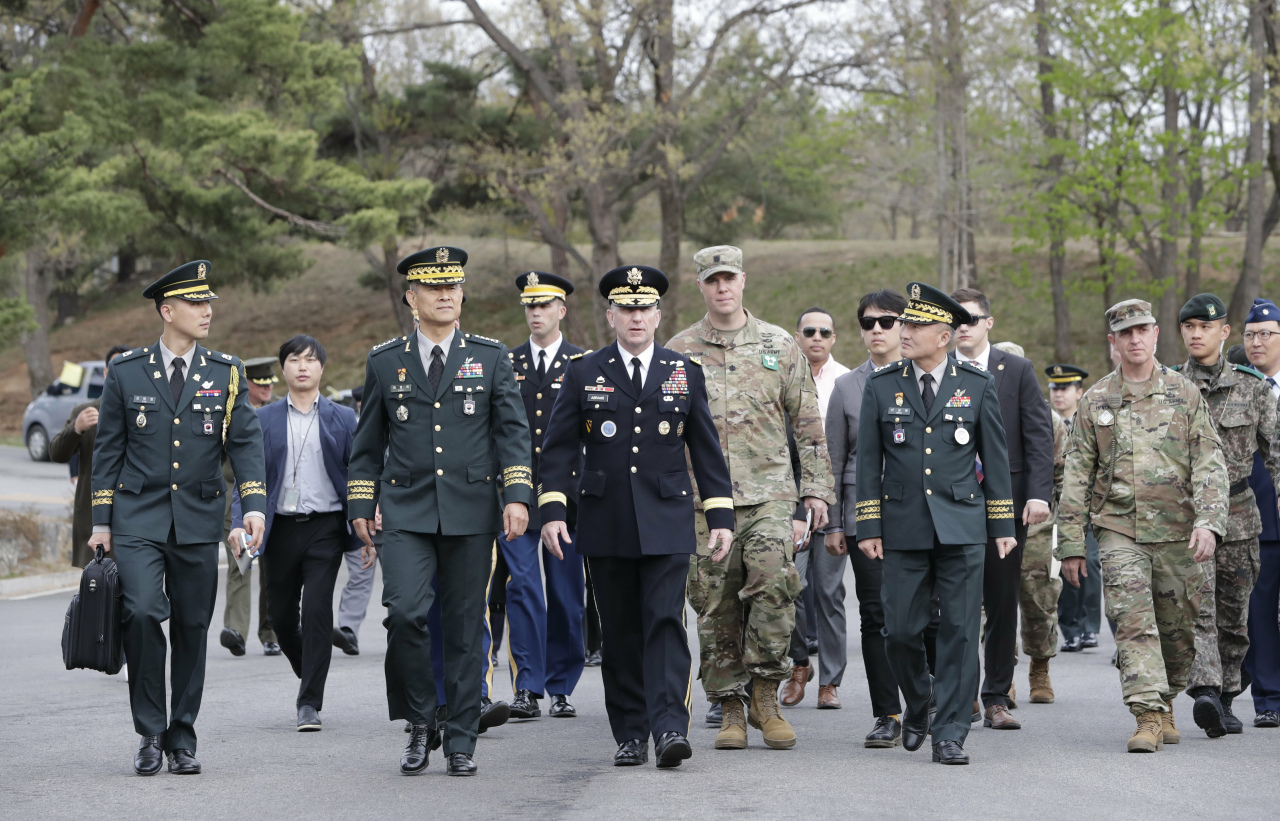 U.S. Gen. Robert Abrams, center, commander of the United Nations Command, Combined Forces Command, and United States Forces Korea, arrives for a ceremony to mark the first anniversary of Panmunjom declaration between South Korean President Moon Jae-in and North Korean leader Kim Jong Un held in April 27, 2018 at the southern side of Panmunjom in the Demilitarized Zone, South Korea, Saturday, April 27, 2019. (AP-Yonhap)
