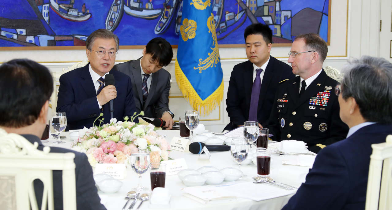 President Moon Jae-in speaks during a meeting with senior US and South Korean military commanders, including Gen. Robert Abrams (right), chief of the US Forces Korea, at the presidential office on Tuesday. Yonhap