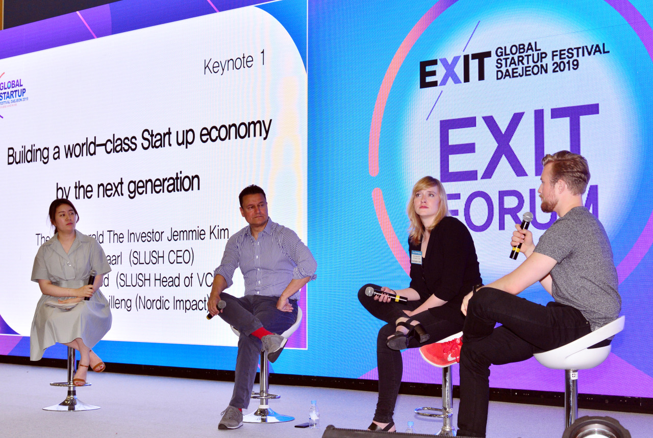The Investor Editor-in-Chief Kim Ji-hyun (from left) and panelists -- Slush Head of VC Moaffak Ahmed, Nordic Impact Co-founder Kaja Kirstine Lilleng and Slush CEO Andreas Saari -- discuss ways to build the startup economy during a panel session of EXIT Forum on Tuesday. (Park Hyun-koo / The Korea Herald)