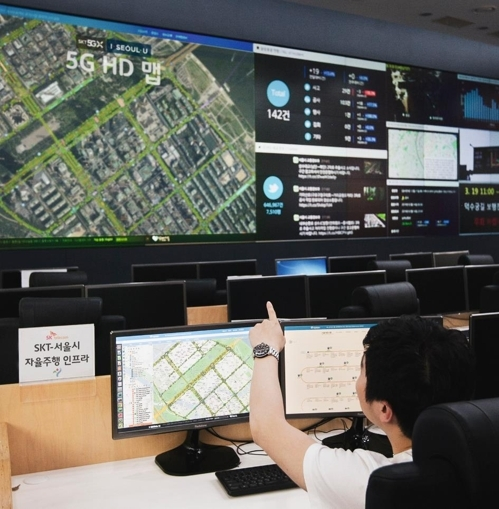 A Seoul city government official watches traffic control system. SKT