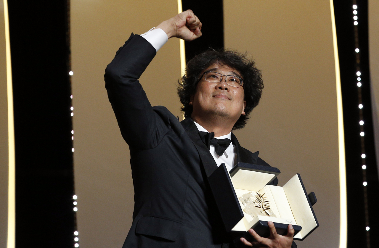 Korean director Bong Joon-ho reacts after being named as Palme d'Or award winner for his film