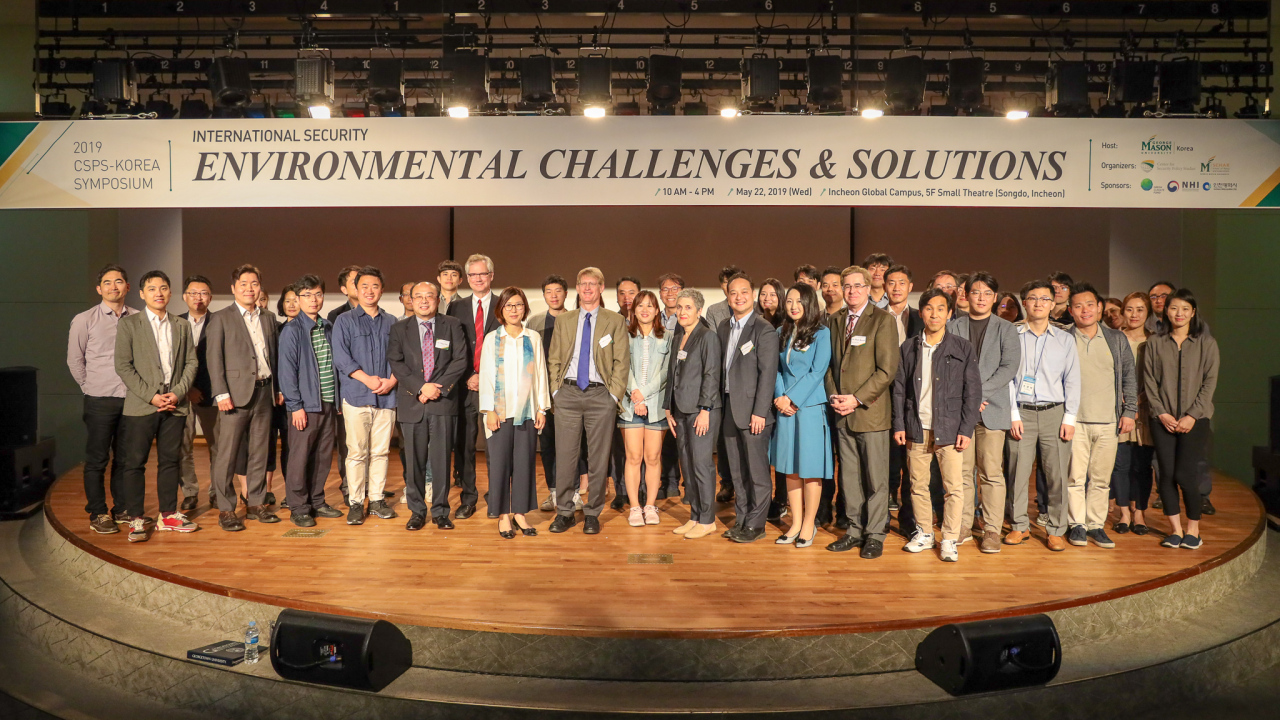 Participants in George Mason University's International Security Symposium on Environmental Challenges and Solutions pose for a group photograph. George Mason University Korea