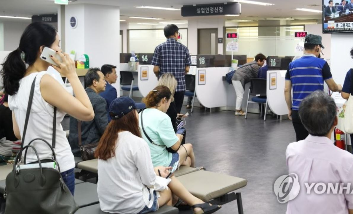 Visitors to the Korea Employment Information Service's unit in Seoul wait for their turn to consult eligibility for the state benefits for the jobless, a day during summer last year. (Yonhap)