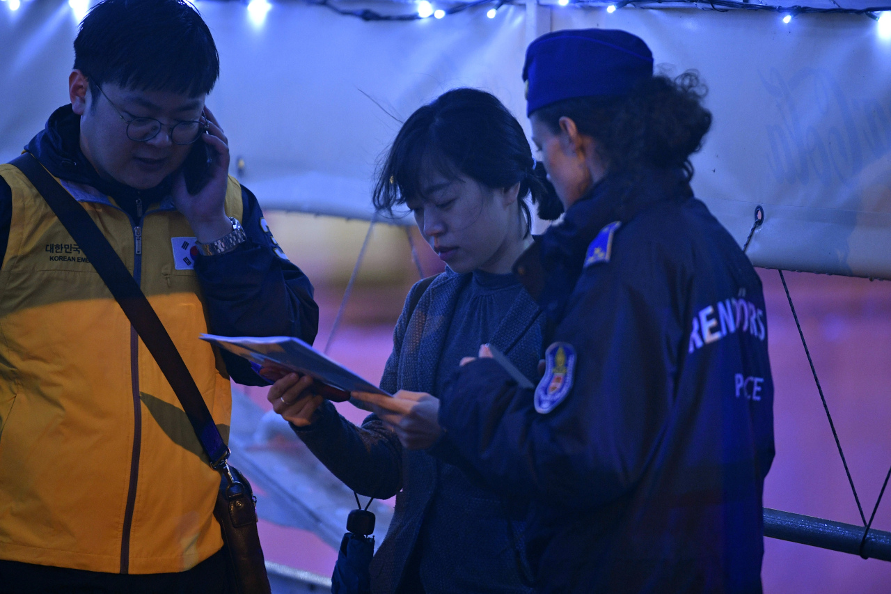 Officials with the South Korean embassy in Hungary work with the local police to identify the individuals involved in the ferry accident on Thursday. Yonhap