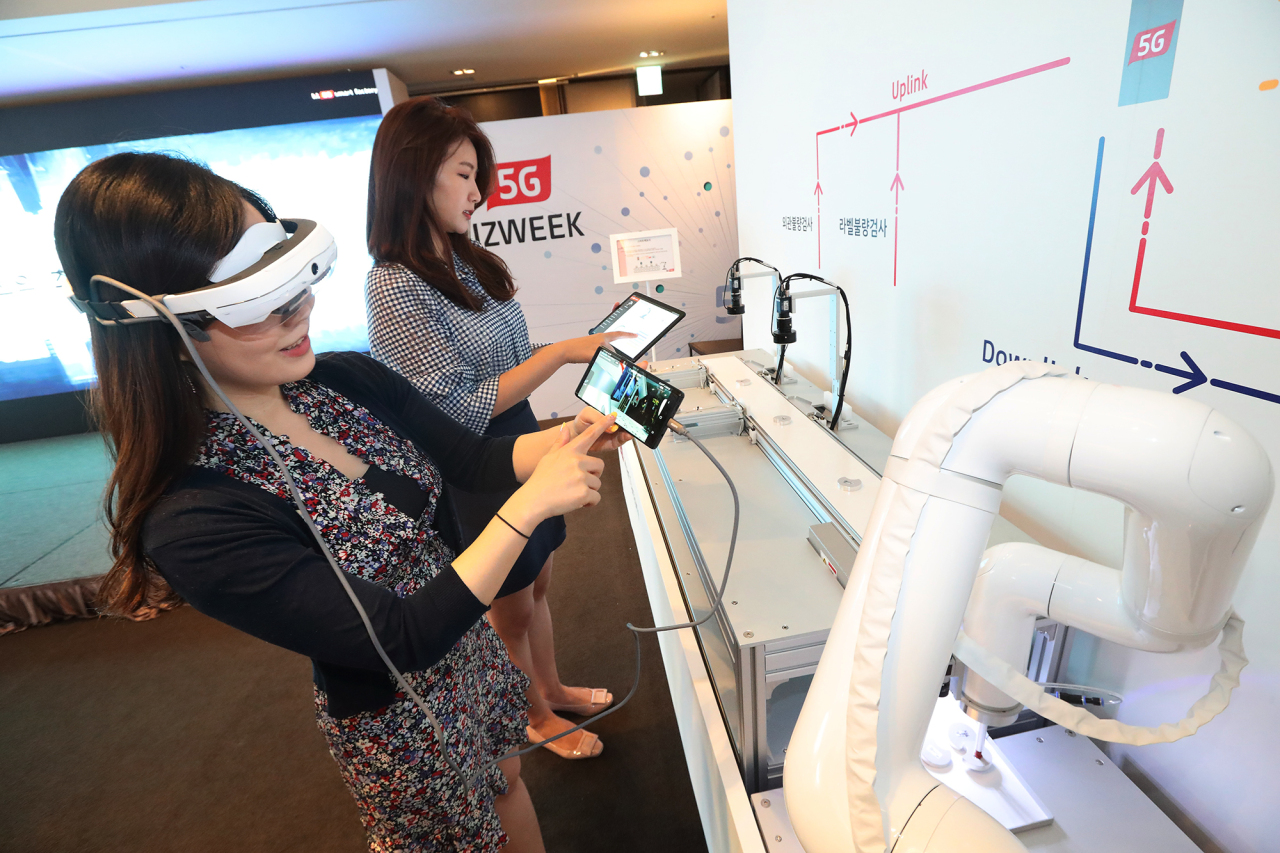 KT officials demonstrates how smart factory works during an event held in Seoul. KT