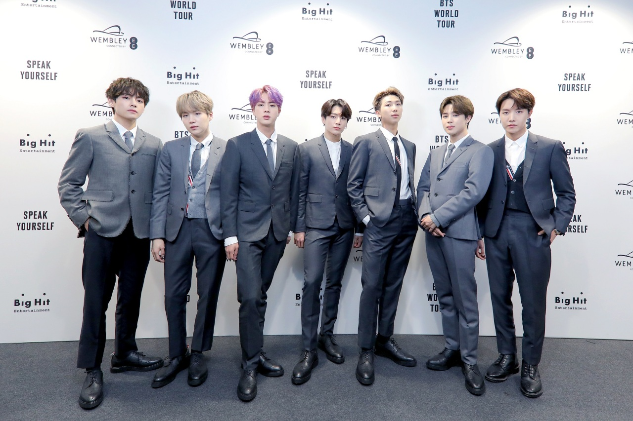 BTS members pose at their press conference at Wembley Stadium in London on Saturday. (Big Hit Entertainment)
