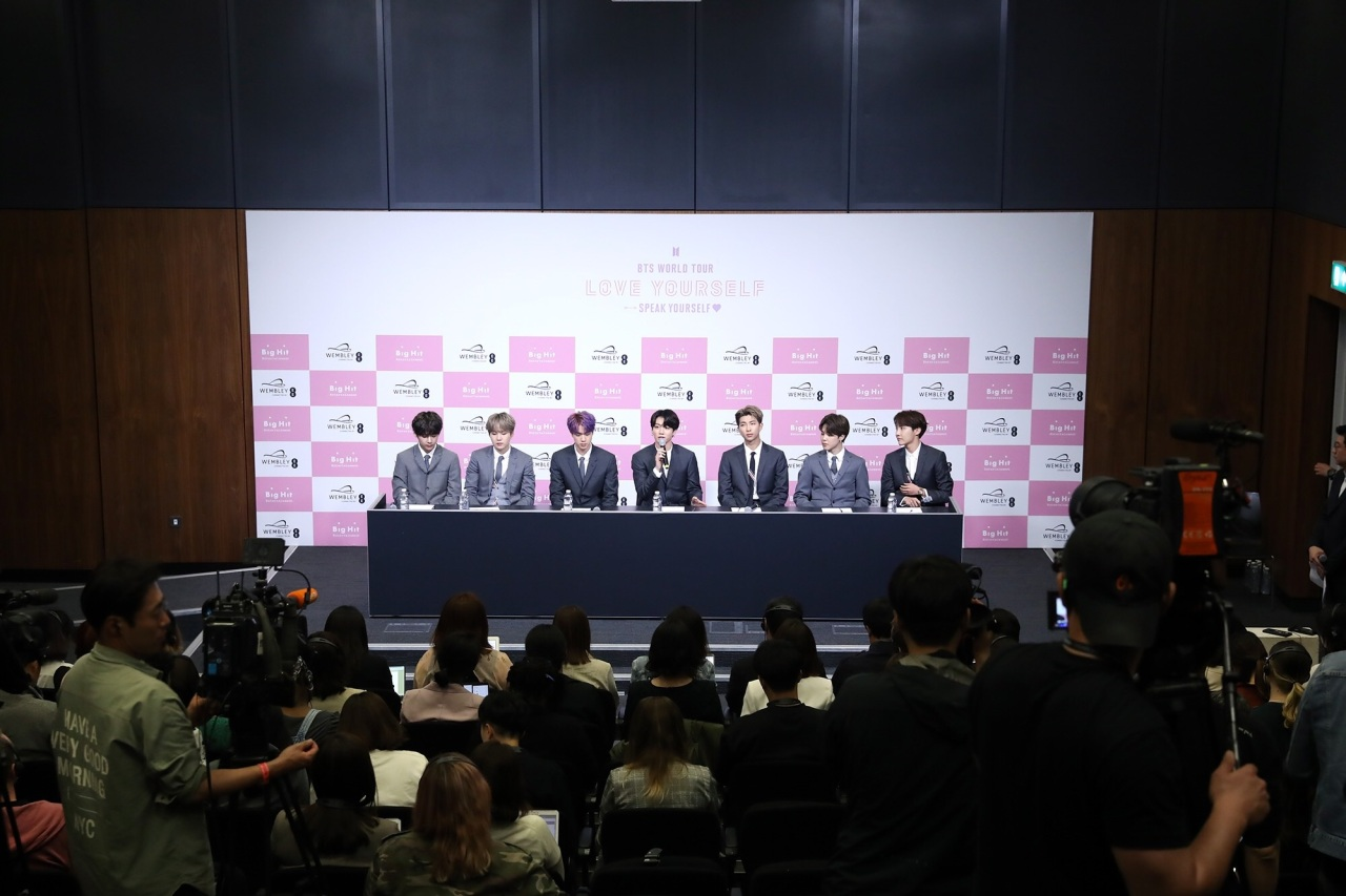 BTS members attend a press conference at Wembley Stadium in London on Saturday. (Big Hit Entertainment)