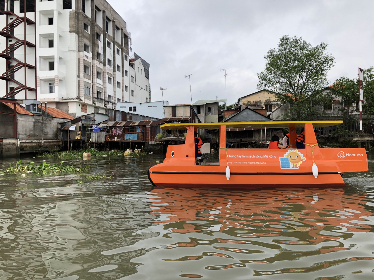 Pictured is a solar-powered trash skimmer boat provided by Hanwha Group. (Hanwha Group)